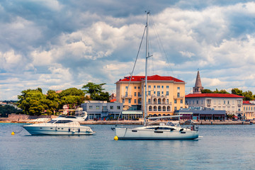Colorful morning cityscape of popular summer resort Porec. Bright spring seascape of Adriatic Sea. Great  scene of Istrian Peninsula in western Croatia, Europe. Traveling concept background.