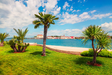Sunny spring view of popular summer resort Porec. Colorful spring seascape of Adriatic Sea. Great morning scene of Istrian Peninsula in western Croatia. Vacation concept background.