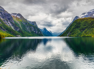 Dramatic summer view of Eikesdalsvatnet lake, Nesset Municipality in More og Romsdal county. Great morning scene of Norway, Europe. Beauty of nature concept background.