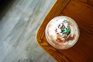 Coffee break time at  coffee shop.Top view of Mocha coffee cup.