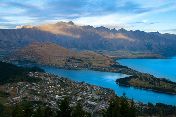 Breathtaking Queenstown New Zealand resort city panorama with The Remarkables mountains range and Lake Wakatipu, the world's capital of adventures, South Island, Otago