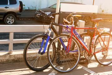 Foto op Plexiglas Fiets Two sports bikes blue and red on the bike path.