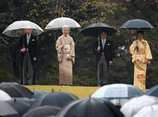 Japan's Emperor Akihito, Empress Michiko, Crown Prince Naruhito and Crown Princess Masako attend an autumn garden party at Akasaka Palace Imperial garden in Tokyo