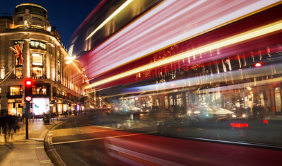 night scene of London city with moving red bus and cars - long exposure photography