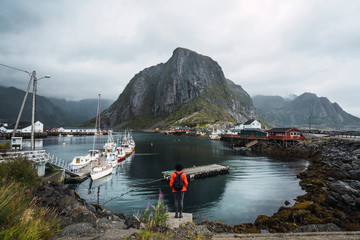 Norway, Lofoten, rear view of man standing at the coast