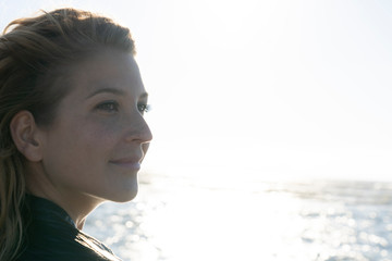 Portrait of a beautiful woman in summer at the sea