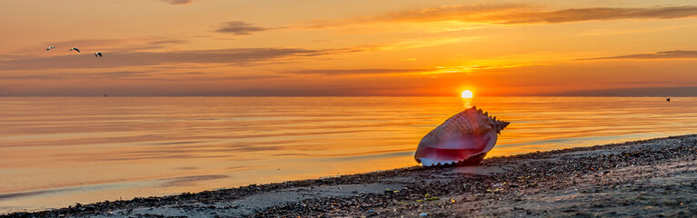 Colorful sunrise on sandy beach of Jurmala - famous tourist resort and recreational place in Latvia, EC