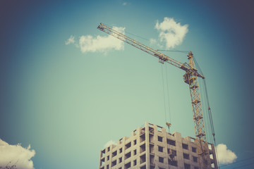 Construction crane and building against blue sky