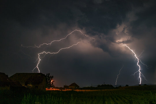 Several lightningbolts strike out of a severe thunderstorm