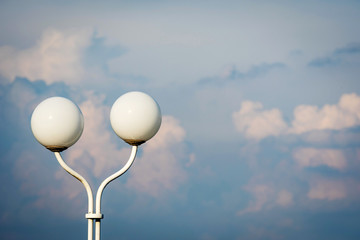 Lantern with two round domes on the blue sky background.