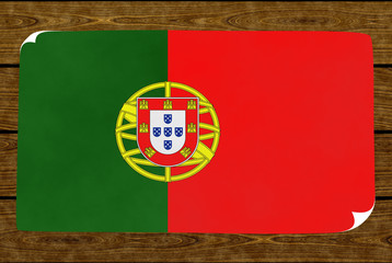 Illustration of a Portugal flag painted on the papier pasted on the woody wall