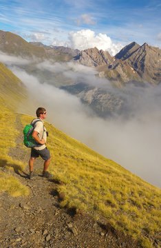 Tourist standing on the way watching mountains on backround, Pyrenees