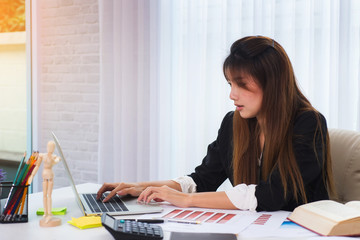 Photo of attractive business woman working on laptop for startup new project at office.