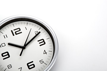white clock face with black digits on a white background closeup