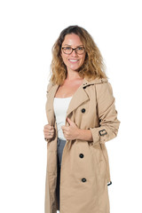 beautiful business woman in glasses and autumn coat isolated on white background. holding a cup of coffee, a notebook, a phone. makes an entry in notebook. checks report. happy face.