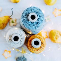 Three natural tweed yarn in bobbins for knitting