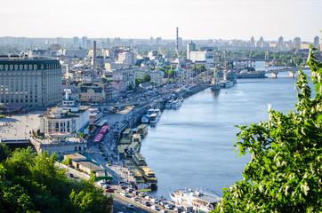 Panorama of city landscape, historical district with river embankment of city Kiev.