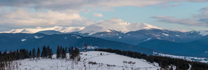 Fototapeta Evening winter cloudy day mountain ridge
