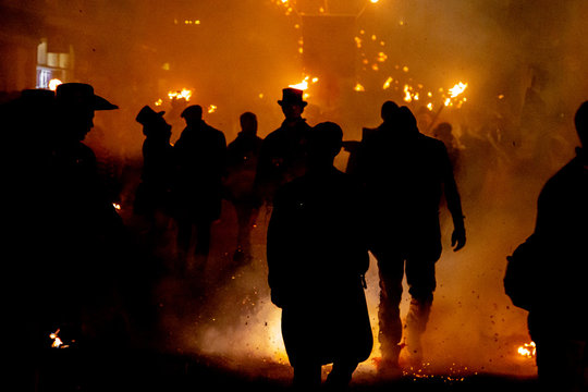 Fire, smoke and silhouetted people at Lewes Bonfire Celebrations