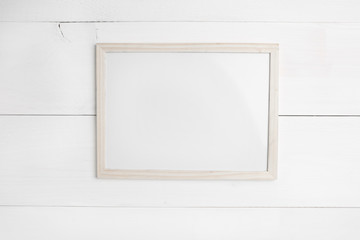Wooden frame on white wooden background