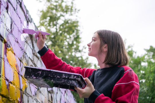Street Artist Making a New Graffiti.