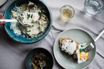 Overhead image of poached eggs and aubergine on toast