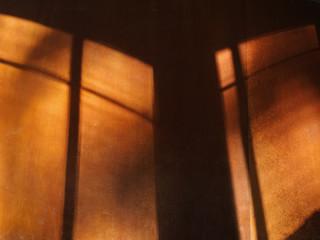 Shadows on a metallic wall