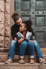 Portraits of a diverse couple in their twenties