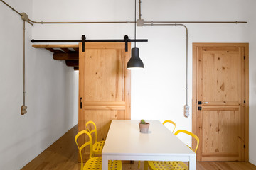 Dining room with yellow chairs
