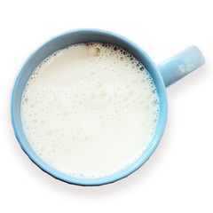 Blue cup of fresh frothy milk isolated on a white background. View from above. Top view of blue cup of milk.
