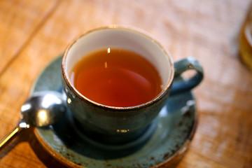 Macro photo of delicious bright tea with herbs