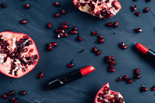 Juicy pomegranate seeds and red lipstick