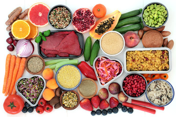 Diet super food selection for weight loss with vegetables, fruit, meat, grains, nuts, spice, supplement powder and herbs for herbal medicine used to suppress appetite. Top view on white wood.