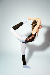 Fashionable fitness instructor stretching