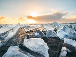 Beach on Eastern seaside of Jokulsarlon with ice chunks, South-East Iceland, Iceland