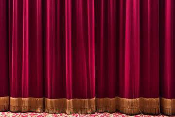 Large red curtain of theatre