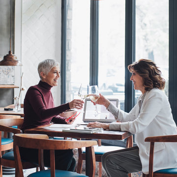 Women Enjoying Talking at Restaurant