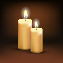 Vector realistic burning candles on a dark background.
