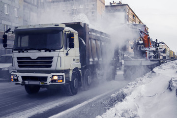 Special transport removes snow on the streets