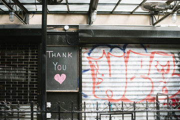 "Closed retail shop with """"thank you"""" sign"