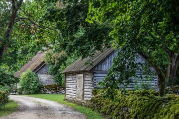 ESTONIA, ISLAND MUHU, 2016-07-30: Traditional log houses with thatched roofs in Koguva on the small island Muhu