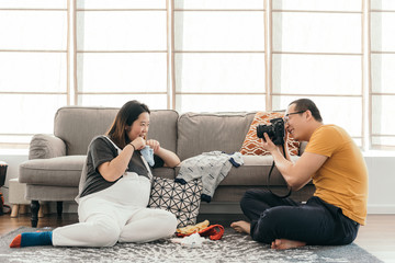 Pregnant woman and her husband at home