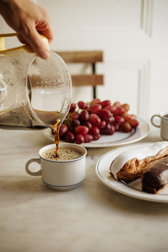 Breakfast with coffee, eclairs and grapes