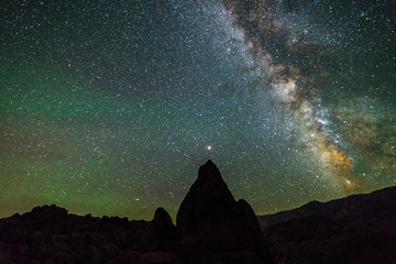 ALABAMA HILLS, CALIFORNIA USA 2018 - Alabama Hills, California rock formation and starry sky with Mount Whitney in background