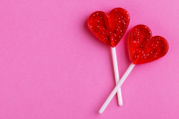 Two red sweet tasty lollipops in shape of heart