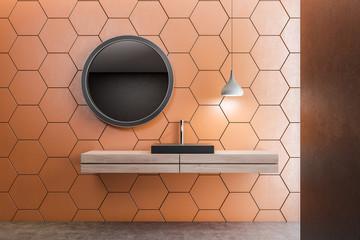 Orange honeycomb bathroom, black sink
