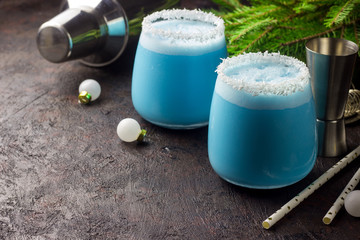 Blue curacao Christmas Cocktail on Christmas decorated holiday table