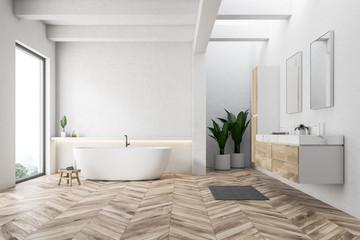 White bathroom interior, tub and sink