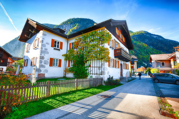 Scenic view of famous Hallstatt viilage. Typical Austrian Alpine houses with bright flowers