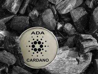 cryptocurrency ADA coin lies on coal. Mining and Energy for mining.